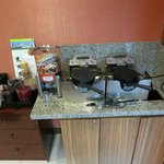 make your own waffles area, dispense batter in cup, put batter in waffle iron, wait 3 or 4 minut