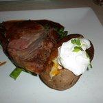 12oz prime rib and fully loaded baked potato