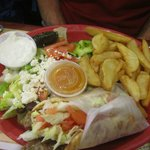 Sandwich wrap, fries and salad