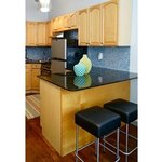 The Suite - Feel right at home in the fully equipped kitchen with granite counter top
