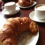 Warm croissants and cappuccino