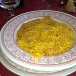 One of the homemade pasta's. The yellow color comes from the yolk of the egg.