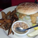 Fried catfish sandwich with white beans and house fries.