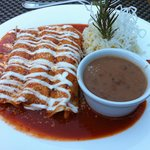 Enchiladas, served with excellent beans and rice