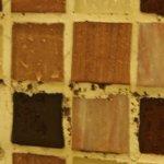 Black spots between tiles