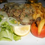 Sirloin steak mushrooms onions chips and salad