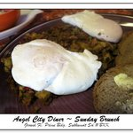 made-to-order corned beef hash and poached eggs w/ rye toast.