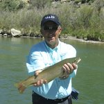My husband with his Brown Trout