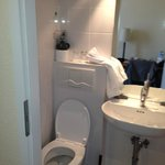 Badly positioned toilet in too small en suite bathroom