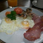 Delicious cooked breakfast...fresh fruit and cereals and juices and home made breads, too!
