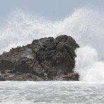 Breaking waves at beach.