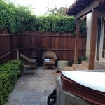 side yard with hot tub