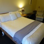 Large comfy bed with electric blankets.