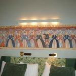 Frieze above the bed