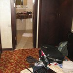From bed to shower room, entrance door on the left, 'fridge on the left