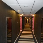 Even the pathway to the rooms welcome you with red carpets
