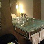 Lovely sink with chic fixtures. In bedroom just outside bathroom door.