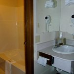 Your private bathroom features a convenient separate vanity and sink area.