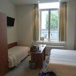 Room 119 - desk in front of window