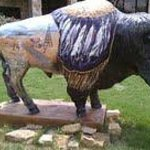 a painted buffalo located at the Visitors Center in Sulfur, OK