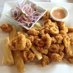 Fried Calamari with yukka fries and onion salad