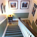 View from stairs of beautiful flooring and paintings