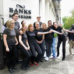 Staff wearing T-shirts in support of contest for #1 hotel in Amsterdam