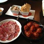 Lomito, meatballs in spicy tomato sauce, and ceviche de cams tones casero.