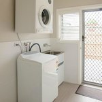 Laundry facilities in each apartment