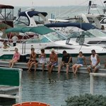 Boaters enjoying the water and the afternoon entertainment.