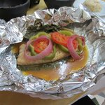 Grouper steamed with banana leaves, veggies in aluminum foil. Delicious beyond words
