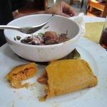 Corn tamale with turkey in black chili sauce