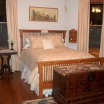 Bedroom with Queen size bed, overlooks swimming pool,back patio and Tower Grove Park