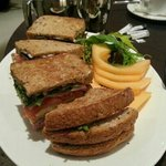 Reasonable club sandwich - got to order chips separately else it comes with...melon?