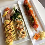 101 roll, spicy crab roll, sashimi and volcano roll.