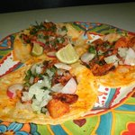 tacos  al pastor   pork marinated  and pineapple  of course onion and cilantro