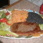 one  of   beef steak  1 pound   with  rice and fried beans and salad