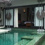 View from private pool loking into bed and living area of villa