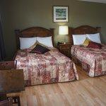 two double beds with hardwood floor