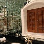 the mirror walled bath tub