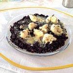 Pieces of Cretan lobster sautéed in a creamy armagnac and black truffle sauce. Wild rice