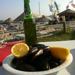 Steamed mussels with rice and a beer - one of my favorite meals!