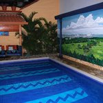 The pool and wall mural.
