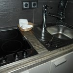 The stove top and sink.