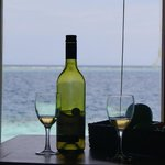 When settling in a water bungalow you are given a wine or champagne small bottle and fruit as a