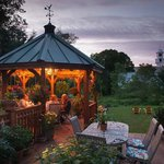 Enjoy our spacious deck and orchid-filled gazebo