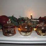 Glimmering votives cast warmth & ambiance to Guest Room