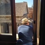 Leaning out and watching Rome go by