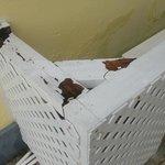 rotting wooden gratework around air conditioner unit