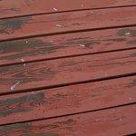 Paint peeling on wooden walkway